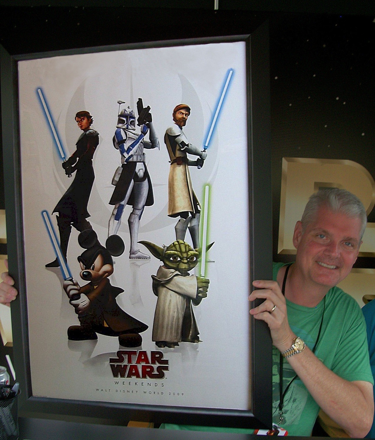 Tom Kane (voice of Yoda) holding the Star Wars Weekends 2009 framed event poster he signed ~ © Dizdude.com