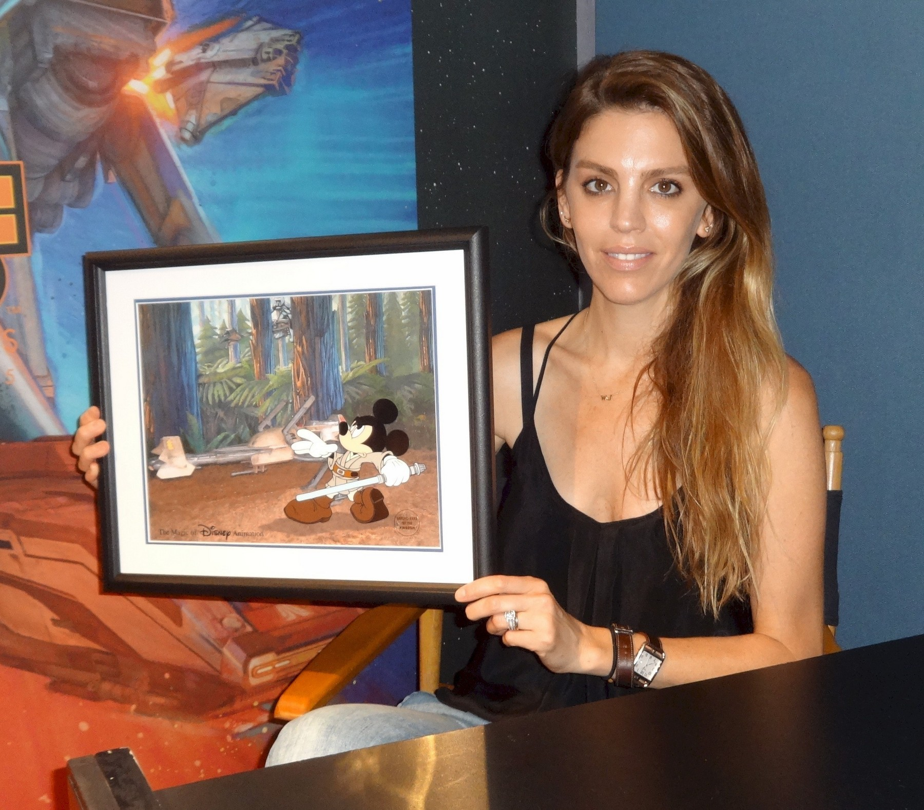 """Amy Allen holding the """"Defend-Ears of the Kingdom"""" Cel after autographing © Dizdude.com"""