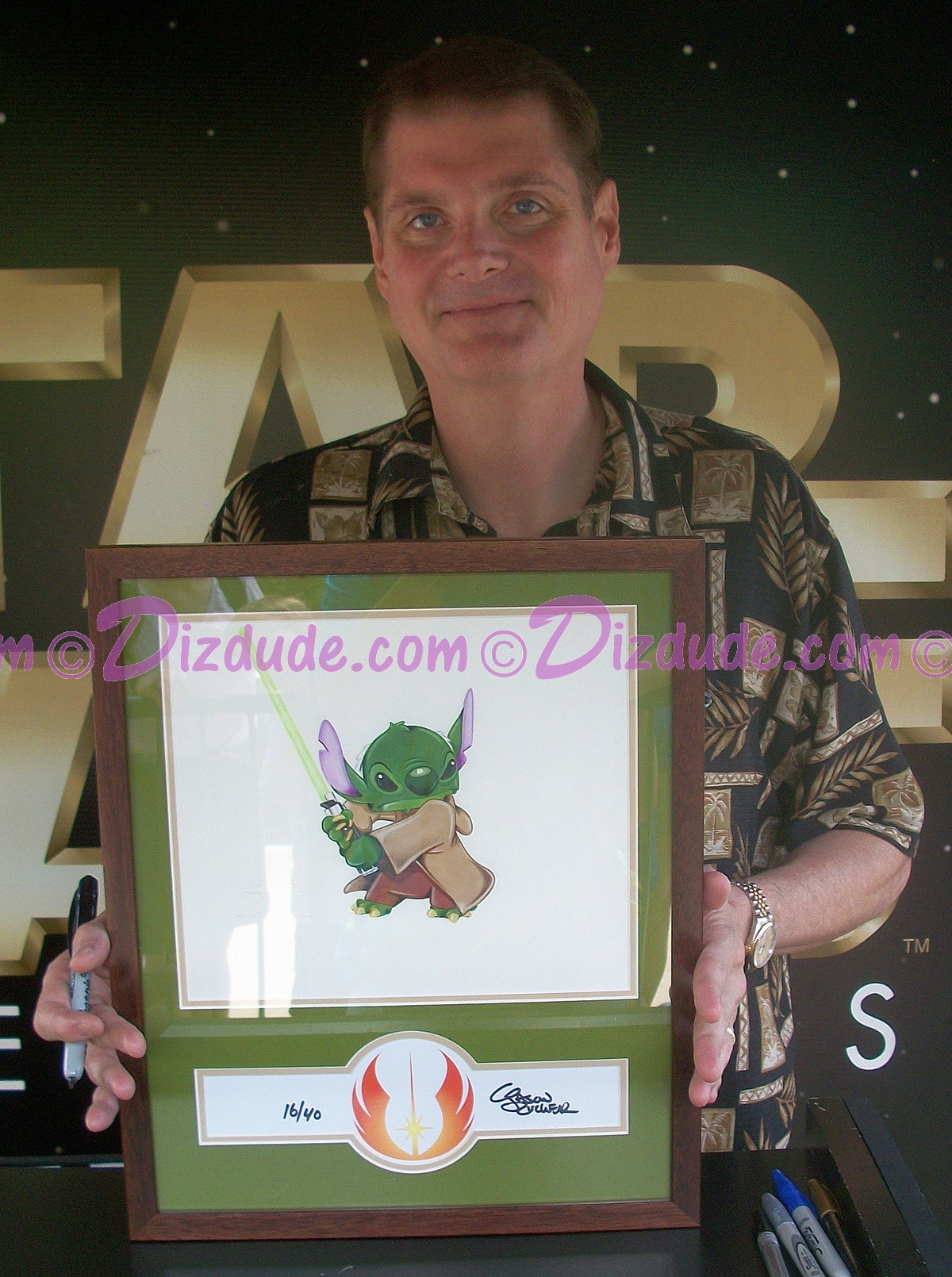 "Tom Kane ""The Voice of Yoda"" Holding this beautiful ""Stitch as Yoda"" Nr 16 illustration June 10, 2011 at Star Wars Weekends ~ © DIZDUDE.com"