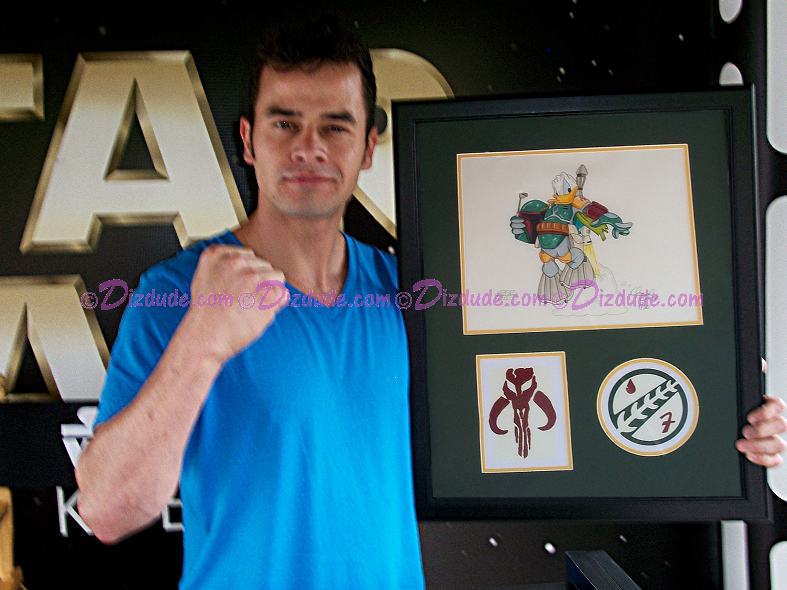 "Daniel Logan (the young Boba Fett) holding the illustration ""Donald Duck as Boba Fett"" after signing it during Star Wars Weekends 2012  ~ © DIZDUDE.com"