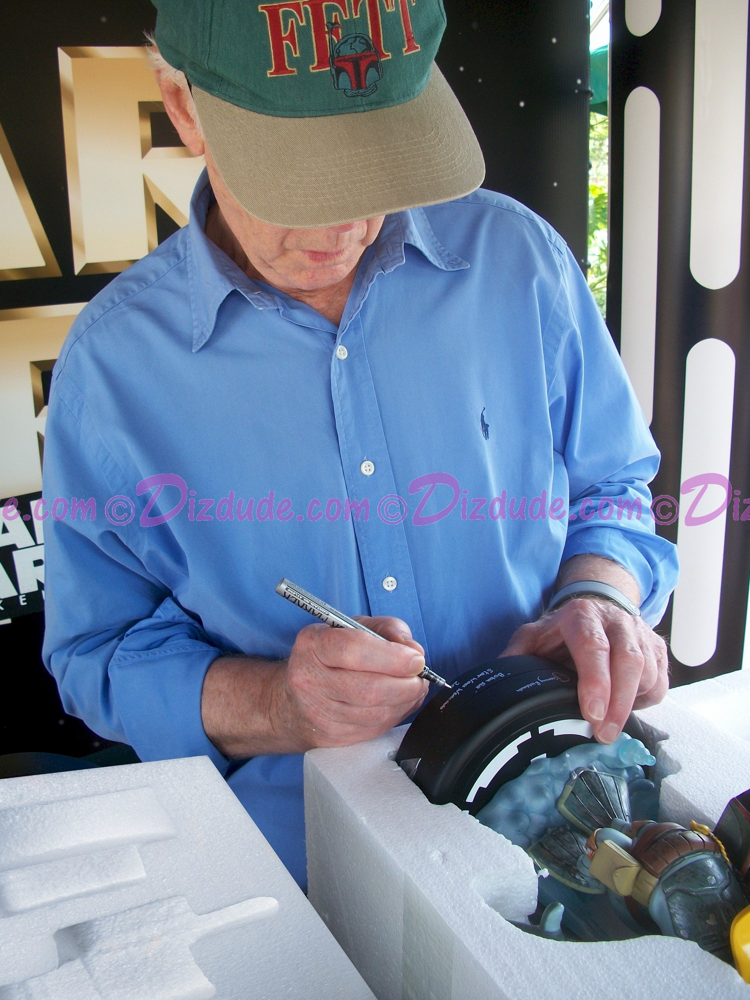 Jeremy Bullock the Star Wars actor who played Boba Fett Autographing the Donald as Boba Fett Medium Big Fig you will recieve this photo ~ © Dizdude.com