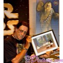"""Double Autographed by STAR WARS Actors Warwick Davis (Wicket) & Peter Mayhew (Chewbacca) Disney Cel """"Defend-Ears of the Kingdom"""" Introduced Jedi Mickey in a scene from STAR WARS: """"Return of the Jedi"""" hand painted by Disney Animation Gallery Black Framed"""