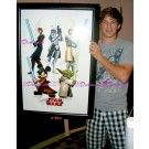 Matt Lanter voice of Anakin holding the framed 2009 Disney Star Wars Weekends Poster prop he signed © Dizdude.com