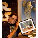 "Peter Mayhew holding the Disney STAR WARS: ""Return of the Jedi"" Black Framed JEDI MICKEY in ""Defend-Ears of the Kingdom"" hand painted Cel just after he autographed the back ~ © Dizdude.com"