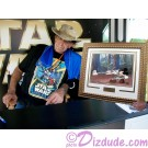 "Peter Mayhew holding the STAR WARS: ""Return of the Jedi"" Gold Framed JEDI MICKEY in ""Defend-Ears of the Kingdom"" hand painted Cel after autographing it ~ © Dizdude.com"