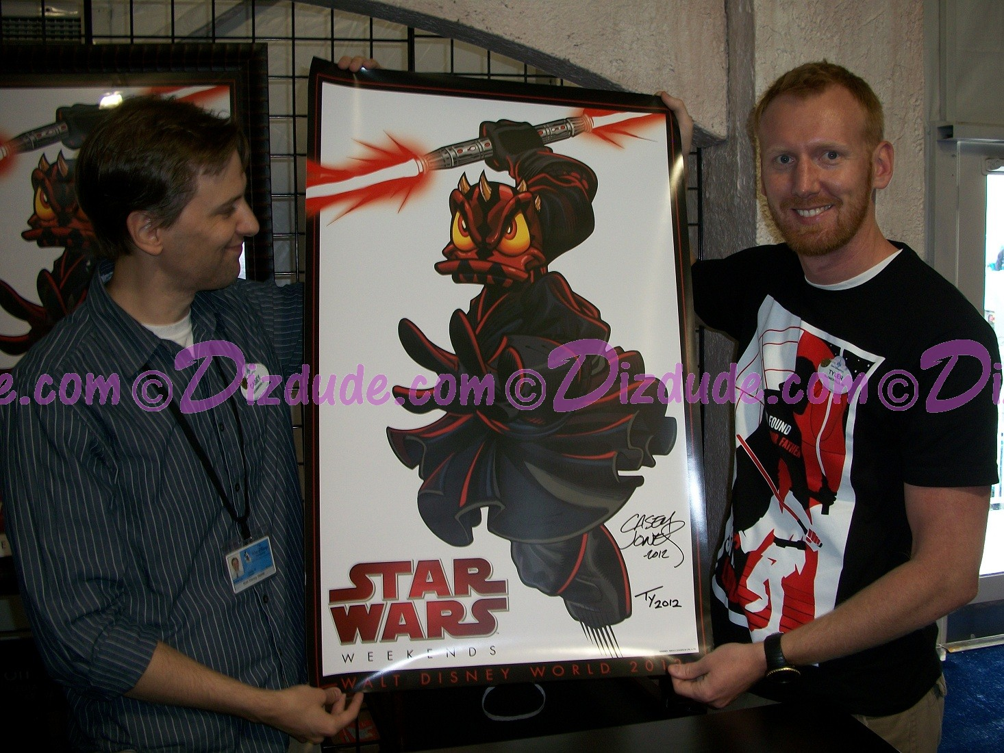 Casey and Tyler Holding the Signed Star Wars Weekends 2012 event Poster - © Dizdude.com