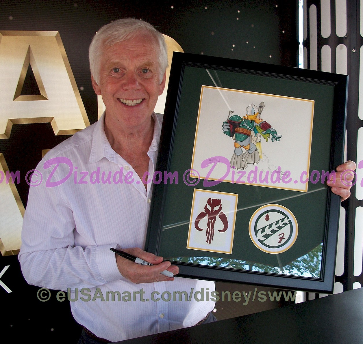 "Jeremy Bullock (Boba Fett) holding the Disney ""Donald Duck as Boba Fett"" illustration after signing it during Star Wars Weekends 2010 ~ © Dizdude.com"