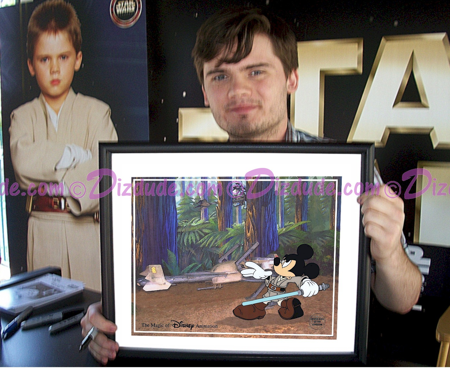 """Jake Lloyd Holding The  Black Framed JEDI MICKEY in """"Defend-Ears of the Kingdom"""" Cel After Autographing © Dizdude.com"""