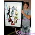 Matt Lanter voice of Anakin holding the framed 2009 Disney Star Wars Weekends Poster prop he signed © Dizdude.com